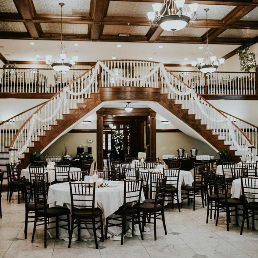 Carl House ballroom with curved staircase!